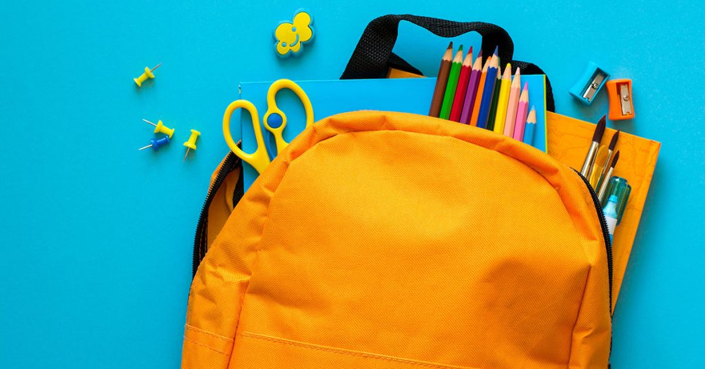 Back to school concept. Backpack with school supplies. Top view. ; blog: Back to School Organization Tips