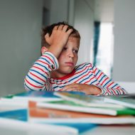 Bored and sad kid looking at computer, problems with online learning, teenager exchaused by remote education; blog: How to Check On Your Child's Mental Wellness