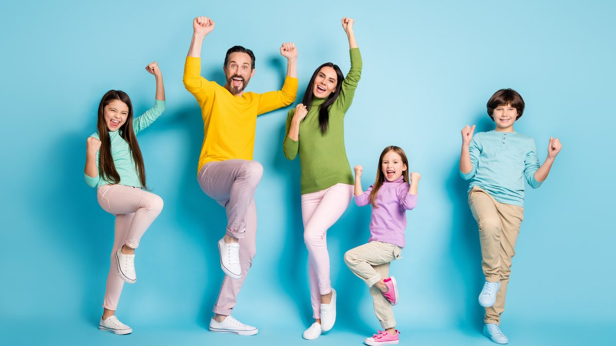Full length body size view of nice attractive lovely adorable ecstatic, overjoyed cheerful cheery big full family celebrating luck isolated on bright vivid shine vibrant blue color background; blog: New Year's Resolutions for the Whole Family